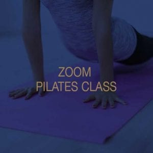 A woman taking part in a zoom pilates class